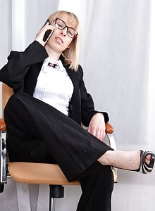Bespectacled secretary Natinella takes a break to finger her bush at work