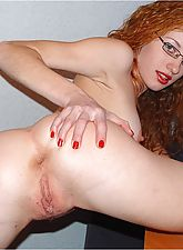 Red Headed Milf Spreads Her Pussy in Office Room