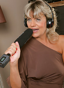 Tan mature blonde Sherry D stops her recording session to open her pussy for you