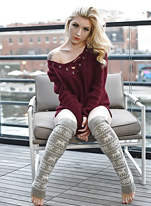 Serious looking blonde amateur Emma York in leg warmers on the roof
