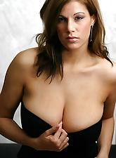 Savantina posing in a sexy black dress