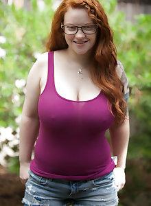 Glasses wearing big tits redhead Kaycee Barnes flashing her boobs in the woods