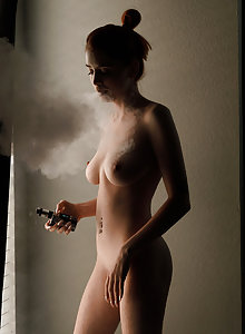 Take a naked smoke break with bunty redhead goddess Wanda Ablee