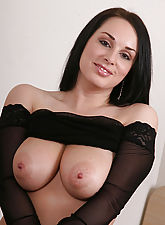 Black haired beauty shows her natural juggs