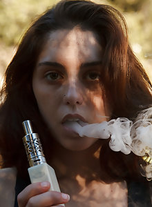 Sexy Christine Ash vaping in the great outdoors