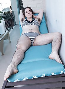 Harley strips naked on her chaise lounger