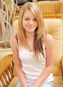 Small framed teen Marianna gets naked and spreads her cooch